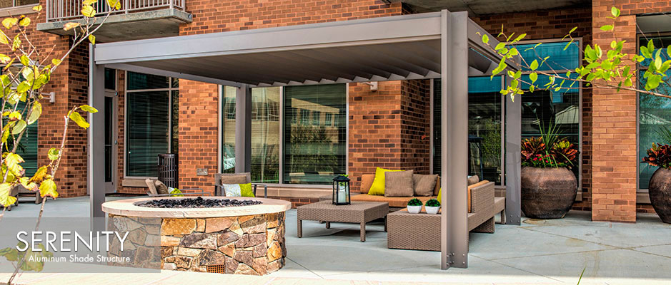 Commercial patio with aluminum louvered shade structure in gray